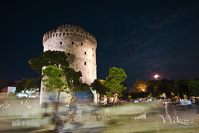 The White Tower with the full moon rising to the right. Since I didn't have a tripod, I had to stabilize myself and the camera on a light post. The motion trail on the bottom was caused by a passing horse & carriage.